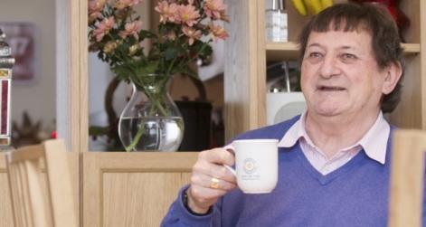 NPH resident holding NPH mug