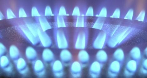 lit gas hob on black background