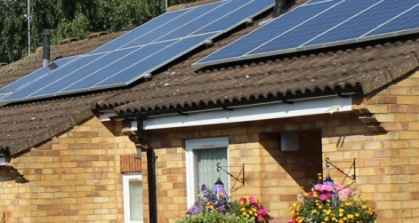 row of homes with solar panels on roof